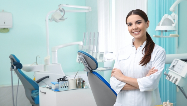 Dentist waiting to greet patients in her efficient dental practice