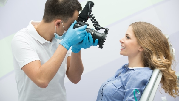 dental braces patient getting orthodontic photography picture taken after completing orthodontic treatment